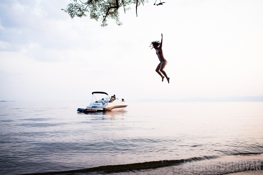 Young Woman Jumps into Lake Champlain on a Summer Day